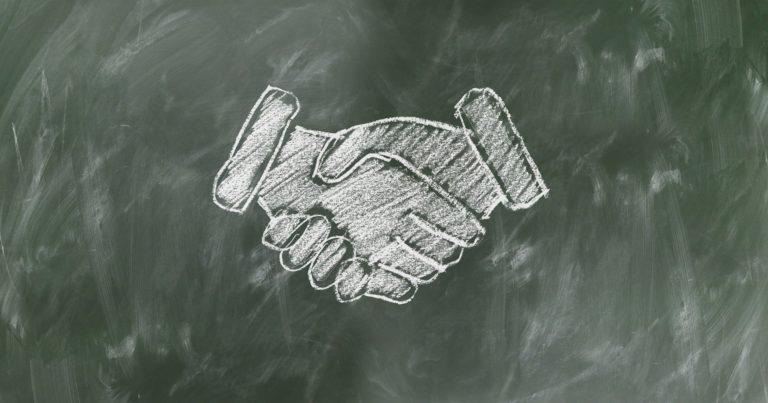 Dessin de mains se saluant représentant l'accueil dans notre agence d'intérim.